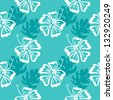seamless vector pattern of silhouettes of hibiscus flowers and palm leaves on the blue background - stock vector
