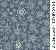 seamless winter pattern with  snowflakes on blue background - stock photo