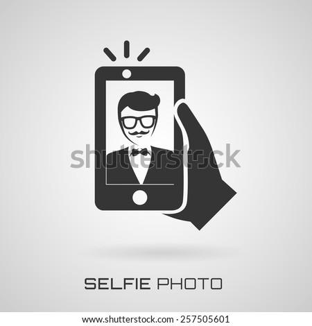 Selfie icon. Trendy man taking a self portrait on smart phone. Vector illustration.   - stock vector