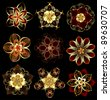 set of abstract, jewelry, gold, stylized flowers on a black background. - stock photo