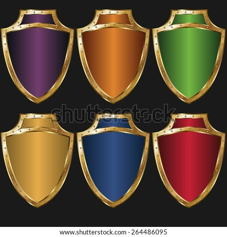 set of colored golden shields - stock vector