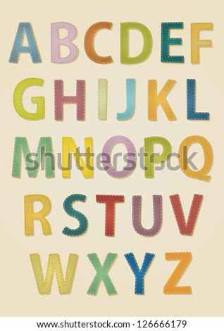 set of colorful stitched uppercase letters on kraft paper background