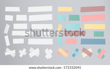 Set of different size, colorful sticky paper, adhesive, masking tape are on gray background