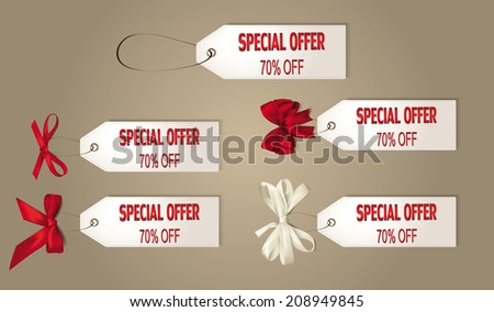 Set of discount tags with the silk red und white ribbons