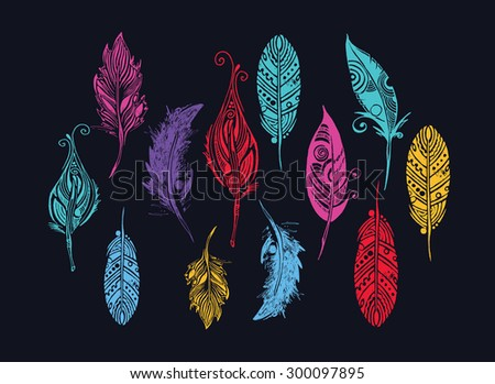 set of  feathers. vector illustration. dark background - stock vector