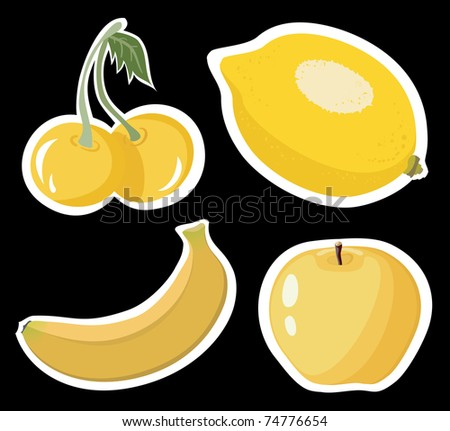 Set of four yellow fruits on black background
