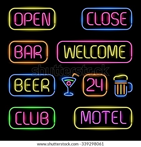 Set of glowing neon signboards on black background