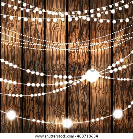 Set Of Glowing White String Christmas Lights For Xmas Holiday Greeting Cards Decoration On Wooden Background