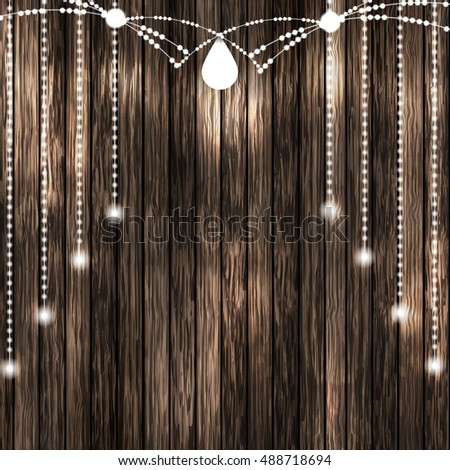 Set Of Glowing White String Christmas Lights On Wooden Background For Xmas Holiday Greeting Cards