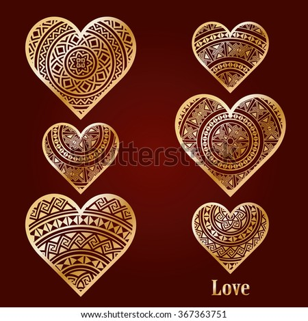 Set of golden hearts decorated in ethnic style isolated on burgundy background. Valentines day love symbols. Vector illustration. - stock vector