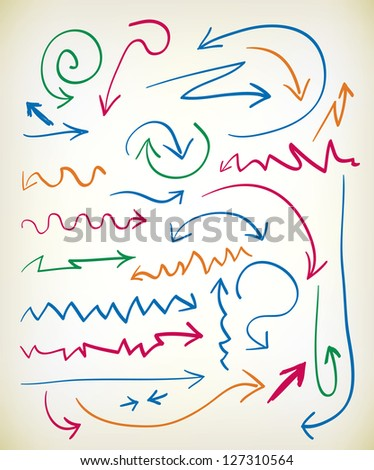 Set of hand drawn arrows in various colored inks with zig zag, curlicue, wavy, and curved lines leading to the arrowhead
