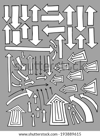 Set of hand drawn  arrows pointing in different directions.  - stock vector