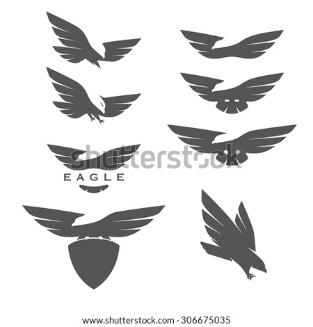 Set of negative space emblems with eagles - stock vector