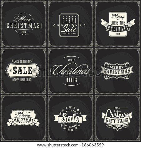 Set of New year and Christmas sale vintage chalk text labels on a blackboard