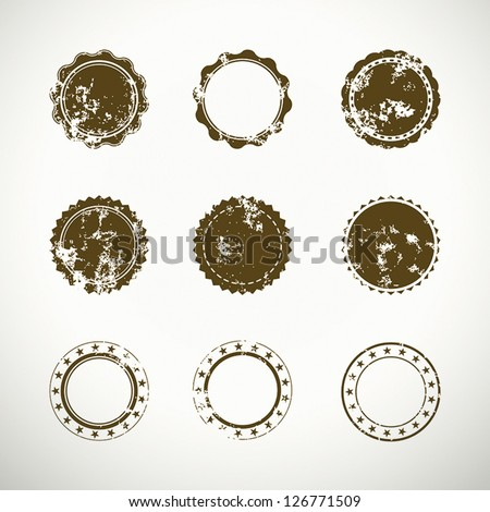 Set of nine round quality grunge stickers and stamps icons - stock vector