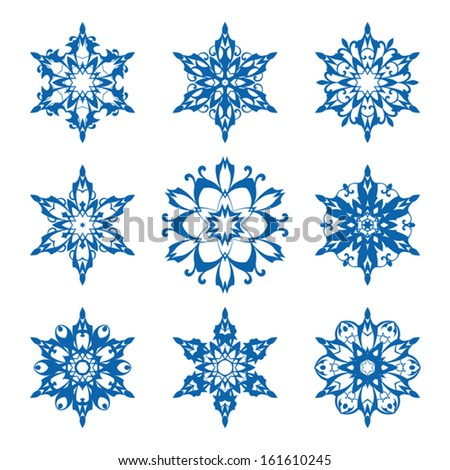 Set of ornamental vector snowflakes on white - stock vector
