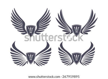 Set of 4 pair of stylish decorative vector wings with shields and crowns - stock vector