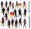 Set of people silhouettes. Happy shopping people holding bags with products. EPS 10.  - stock