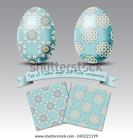 Set of realistic eggs with floral ornaments isolated on grey background. Easter collection: realistic eggs, patterns and ribbon for your text. Happy Easter day vector clip art for your design.