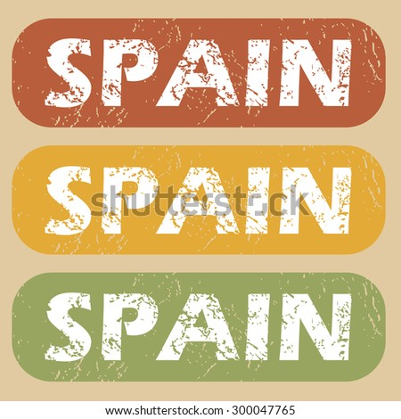 Set of rubber stamps with country name Spain on colored background - stock vector