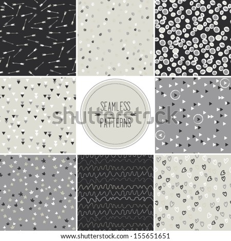 Set of seamless patterns in gray tones with doodled dots, arrows, hearts,stripes,circles,stars, triangles and other geometric symbols, vector repeating texture - stock vector