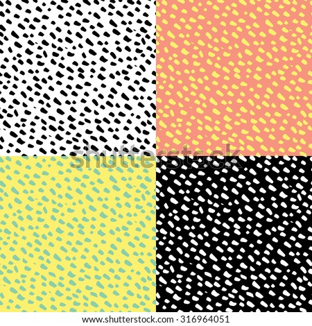Set of seamless patterns with ink spots - stock vector