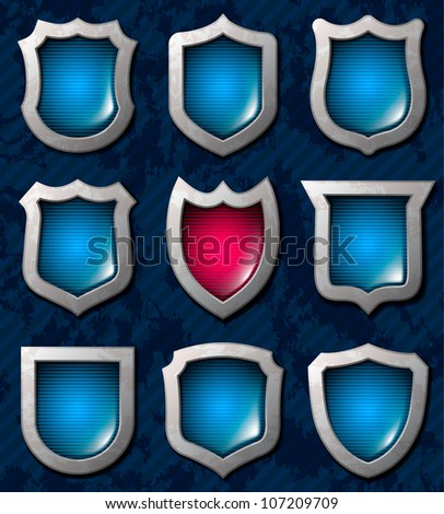 Set of shiny shields - stock vector