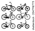 Set of silhouettes of bikes, isolated on white. - stock photo