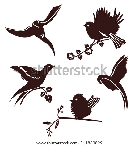 Set of silhouettes of birds on branches of trees black on white background