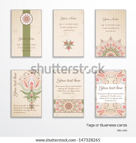 Set of six vertical business cards or tags. Oriental floral pattern on vintage background. Complied with the standard sizes.  - stock vector
