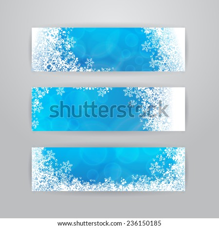 Set of three horizontal banners with snowflakes on blue blurry background - stock vector