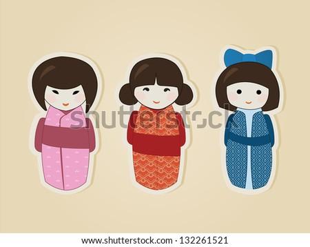 Set of three japanese kokeshi dolls in colorful kimonos on beige background - stock vector