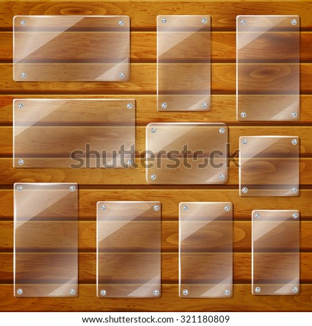 Set of transparent glass plates of different shapes, bolted to wooden planks - stock vector