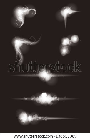 Set of Vector glowing special light effect graphic elements with sparkles - stock vector