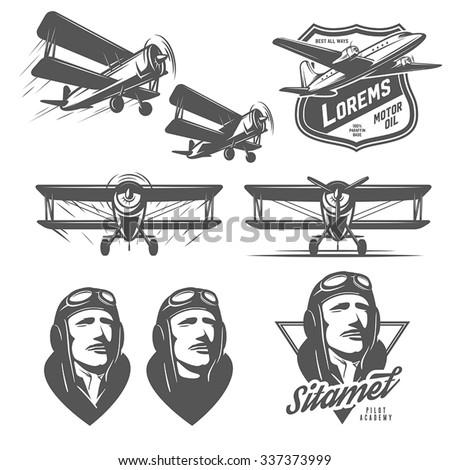Set of vintage aircraft design elements. Biplanes, pilots, design emblems - stock vector
