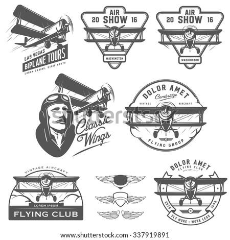 Set of vintage biplane emblems, badges and design elements - stock vector