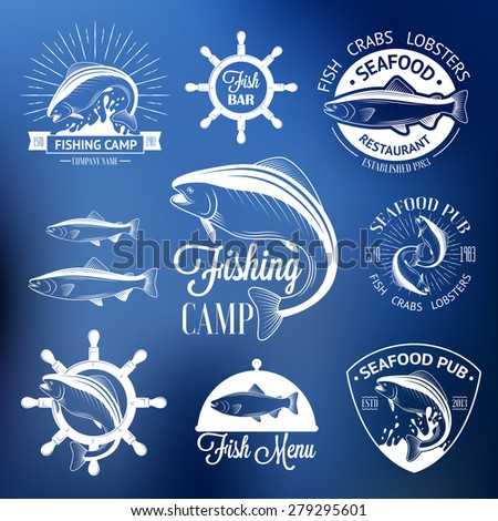 Set of vintage fish logos with helm, sunburst and salmons on blurred background - stock vector