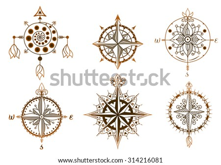 Set of vintage wind roses, compasses. Icons and design elements. - stock vector