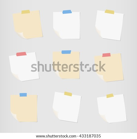 Set of white and brown note paper with folded corners are stuck on gray background