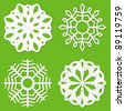 Set of white paper snowflakes on a green background - stock vector