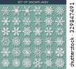 Set 36 white different snowflakes of handmade with long shadow. Snowflake Flat. New Year's symbols. Snowflakes for design. Winter objects. Festive elements. Snowflake Doodle. Snowflake Sketch - stock photo