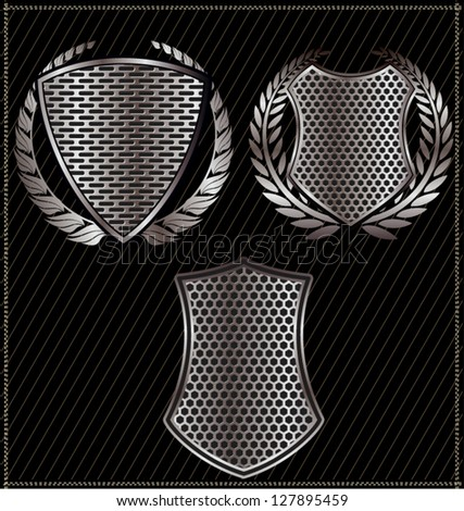 Shields with perforated metal and laurel wreath - stock vector