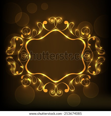 Shiny floral design decorated golden frame on brown background.