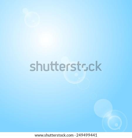 Shiny lens flare on blue sky. Vector design - stock vector