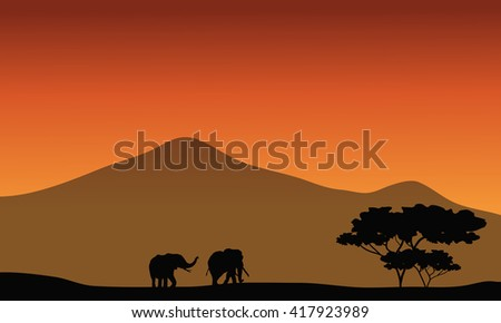 Silhouete of elephant in fields with mountain backgrounds - stock vector