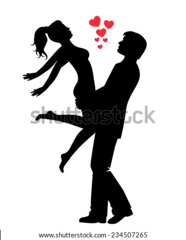 silhouette of a happy loving couple. Man holds woman in his arms, and the woman spread her arms.