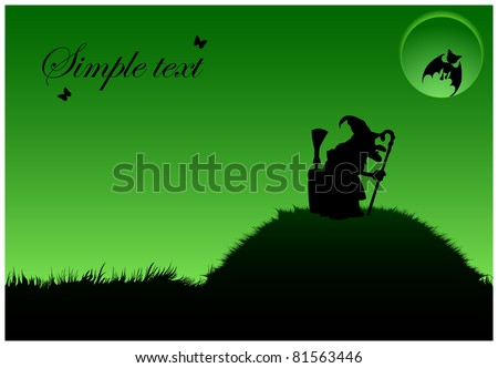 Silhouette of a witch in a cap that is on a hill with a crutch under the full moon