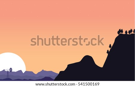 Silhouette of cliff and windmill scenery