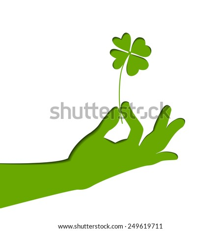 Silhouette of hand, holding four-leaf clover. Green paper illustration. Vector art on Patrick's day. - stock vector