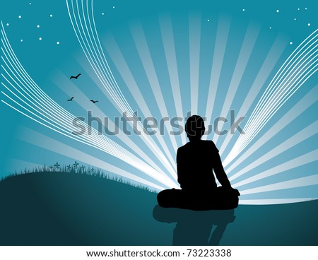 silhouette of person meditating in meadow